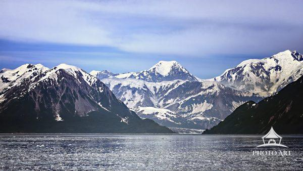 Panoramic view of glacier and glacial water coming in toward Juneau, Alaska.
