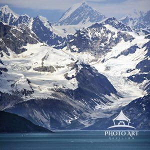 Amazing scene of water, ice, glaciers and mountains coming into Glacier Bay, Alaska by cruise ship.