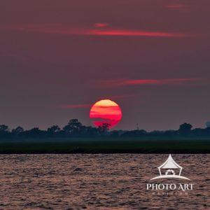 The sun transforms into a fireball as it sets into the horizon