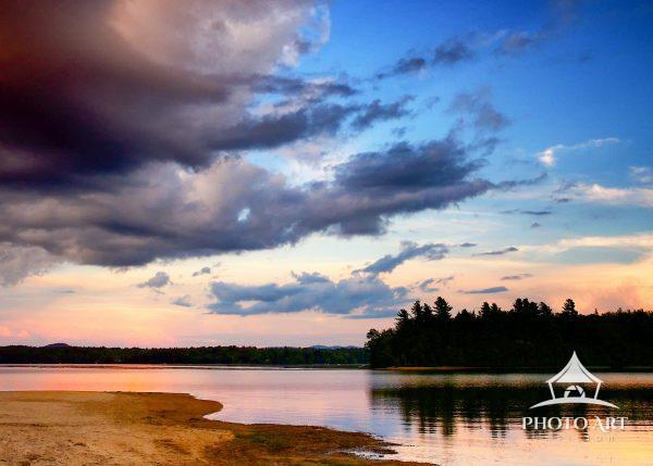 Perfect evening of color and light illuminate a tranquil Adirondack lake at dusk.
