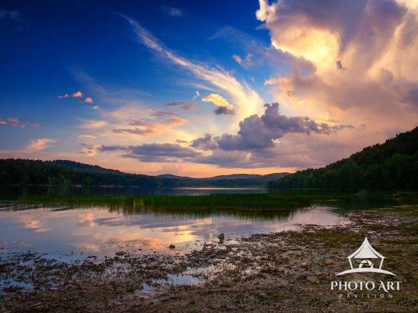 A perfect evening of color and light illuminate an Adirondack lake at dust and combine to create a
