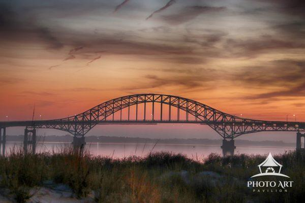 Fire Island Inlet bridge from Captree State Park at sunset.