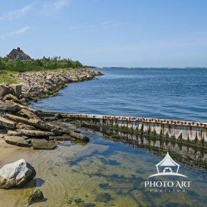 This image captures the shoreline of the inlet at the western most tip of Fire Island.