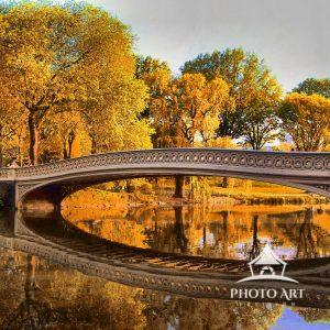 Bow Bridge, seen here in the fall, was the first cast-iron bridge built in Central Park and is the