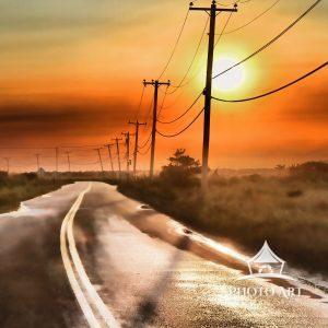A beautiful sunset appears after a passing rainstorm on a very quiet Dune Road in Hampton Bays, NY.