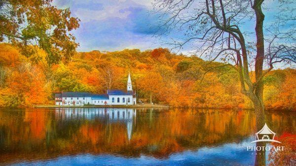 St. John's Episcopal Church is reflected in the Mill Pond on this spectacular fall day in Cold