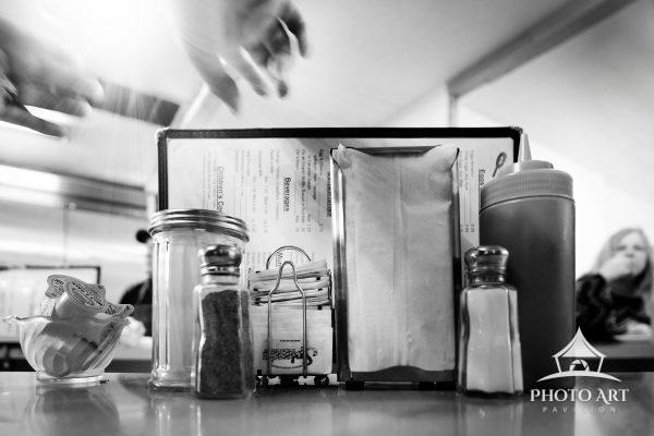 Amazing old diner highlighted in black and white photograph. Remember sitting at the counter