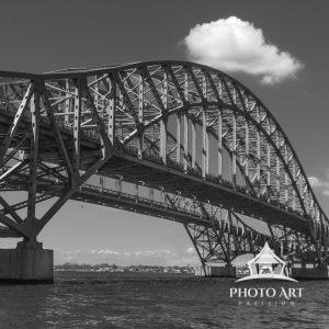 Semi Silhouette of Robert Moses Bridge with its superstructure glowing in the mid day sun. (Black
