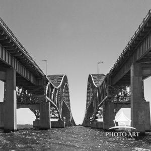 Beneath the Robert Moses Bridge, taken from a boat. (Black and White Version)