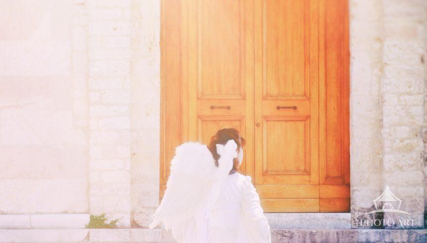 Angel outside the Basilica di Santa Chiara, in Assisi, Italy
