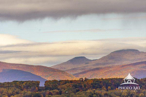 The sunlight came out to brush color on the hills in the background highlighting the autumn colors.