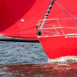 Bowsprit extended & chute drawing nicely.   Great Red-on-Red shot.