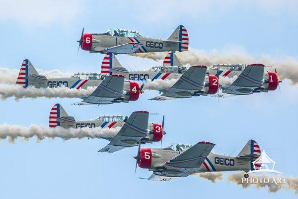 Geico SkyTypers performing in the annual Jones Beach Airshow.   Close-quarters flight crossing.