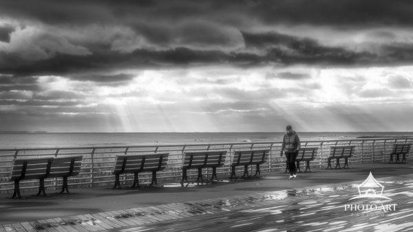 Enjoying a walk on the boardwalk on a cloudy day.