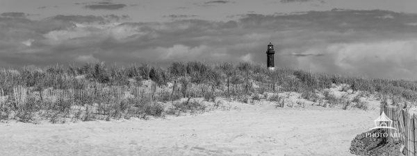 Fire Island Lighthouse in black and white with the leading line of a beach fence.