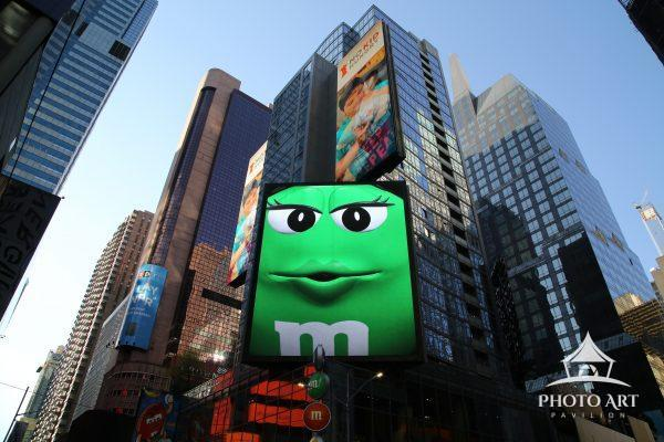 Green M&M on digital billboard in Times Square, NYC during 2020 lockdown.