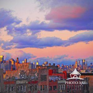 Brooklyn rooftops and Manhattan skyline from the hill in Sunset Park at twilight