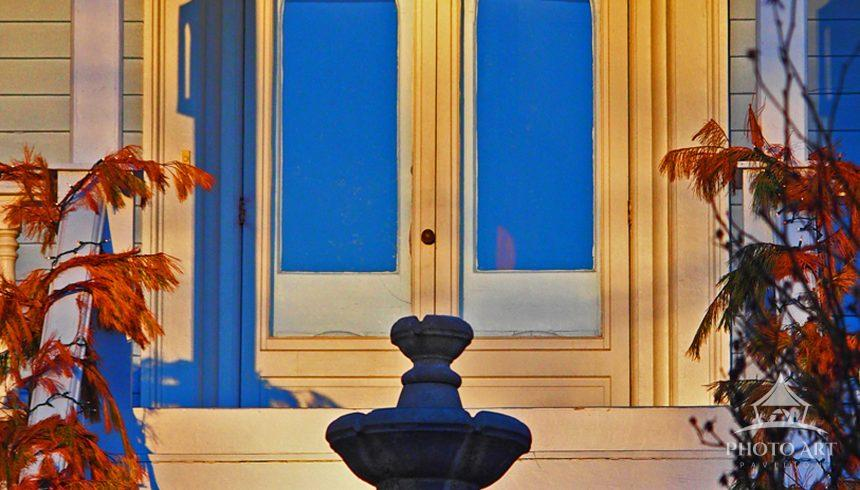Double doors of blue and gold in the late afternoon light
