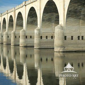 Arches of a railroad bridge over the Susquehanna River march into the horizon