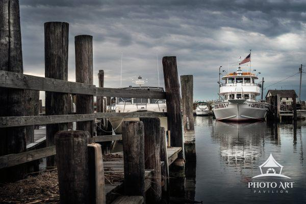 Large boat near the fishing pier in the marina at Captree State Park. Long Island, NY. Color