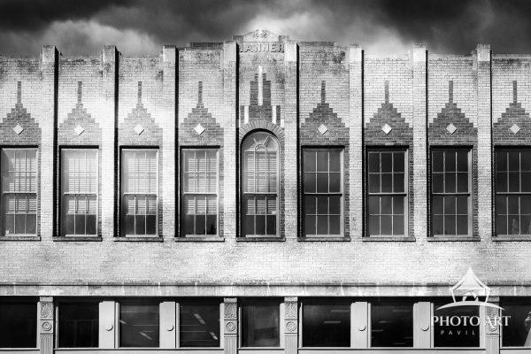 Amazing old brick building, with man old windows in Tennessee. Black and white photograph.