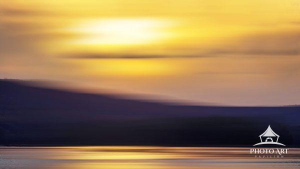 Tranquil scene at sunset along the Susquehanna River near Harrisburg, Pennsylvania with motion blur