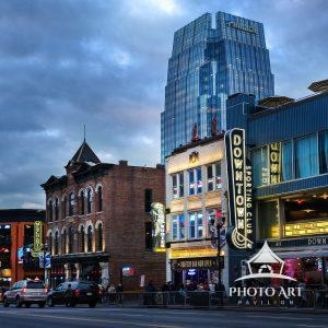 The city street of downtown Nashville as the sun sets and the lights come on. Nashville Tennessee.