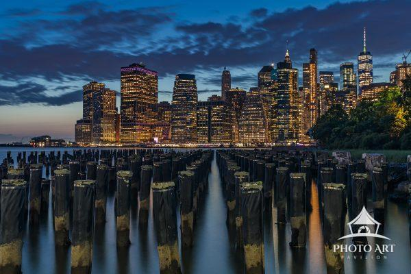 Lower Manhattan at twilight viewed from the old Brooklyn Dock pilings.