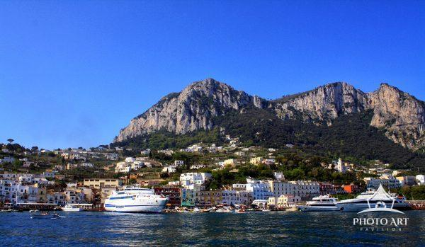 The view of Capri, Italy from the water on a beautiful spring afternoon.