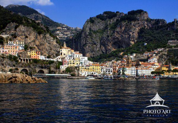A view of the colorful harbor and mountains of Positano, Italy along the Amalfi coast.