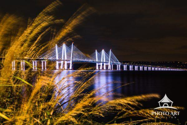 The Mario Cuomo Bridge lights up the Hudson River on a warm autumn evening.