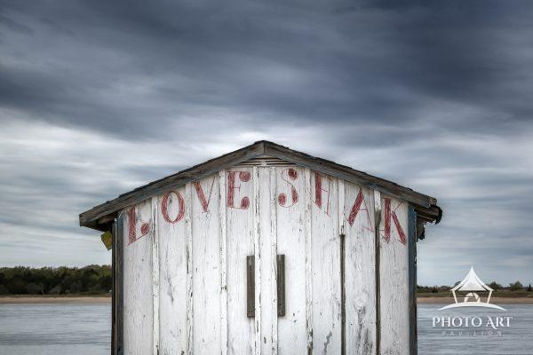 Little abandoned fishing shack along the coast on the North Shore of Long Island, New York. Color