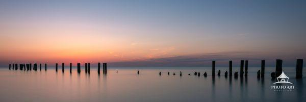 The calm of the Gulf of Mexico and last light over the old pilings of the Naples Pier.