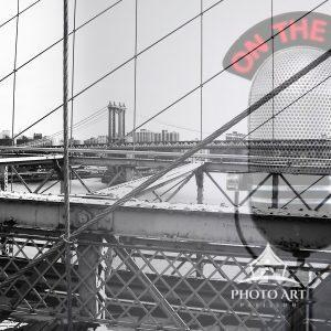 Digital double exposure. NYC bridge with overlay of a microphone