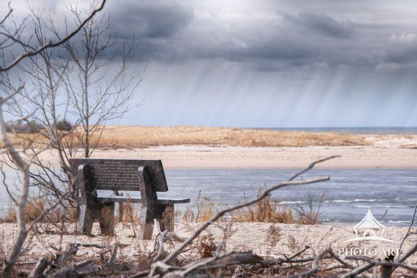 Bench along the shore, with the Fisherman's Prayer inscribed on its back... facing the water of the