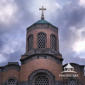 Beautiful old church in Queens, NY against the backdrop of amazing and textured clouds. Astoria,