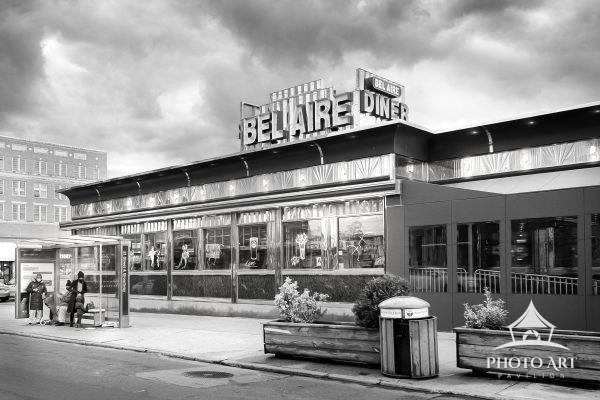 An old diner along the street of Long Island City, Queens, NY, and people at the bus stop. Street