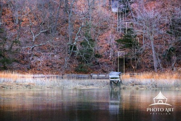Old stairs coming down along a cliff to an old dock on the North Shore of Long Island. Color