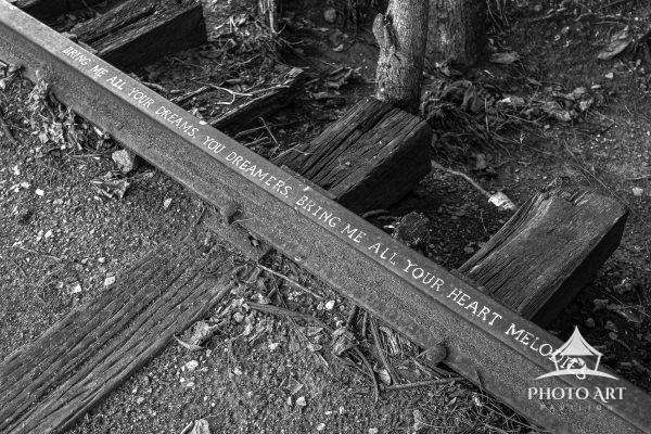 "Inscribed on an abandoned railroad track in Durham, NC are the opening lines from the ""The Dream"