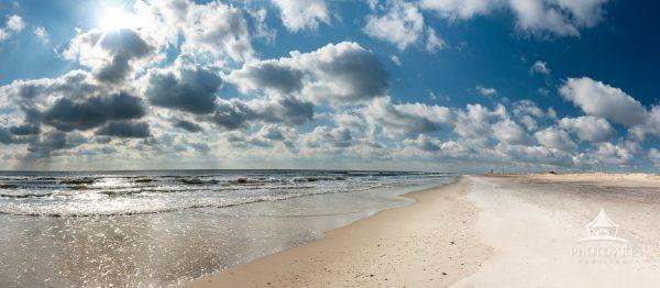 An incredible winter's day at the beach. Look at those beautiful clouds. Don't let this scene fool