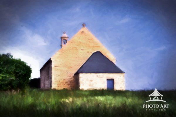 A small chapel in the field shortly after sunrise at Port du Crouesty, Brittany, France.