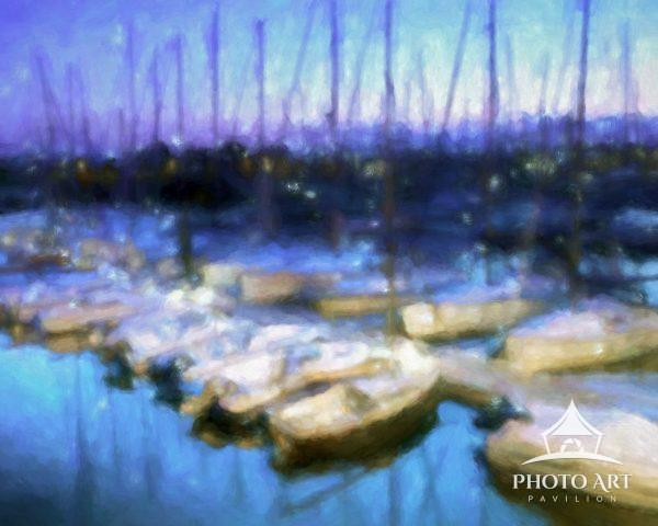 Boats docked in the harbor at Port du Crouesty, Brittany, France during the blue hour.