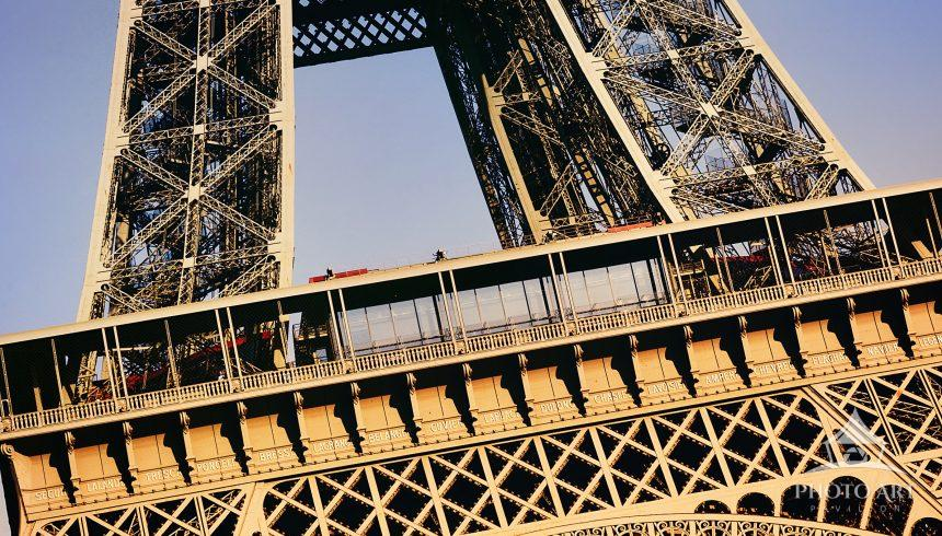 Close up view of the Eiffel Tower looking up from below.