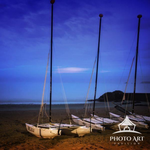 Boats docked on the sand at the beach at Saint Malo, Brittany, France.