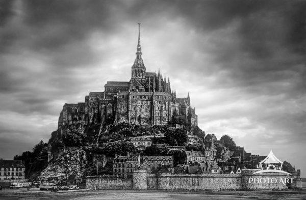 The famous abby of Mont Saint-Michel on an island in Normandy, France in black and white.