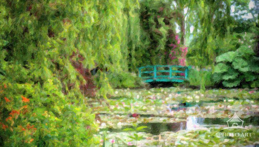 The lush gardens and famous bridge painted many times by Monet at his gardens in Giverny, France.