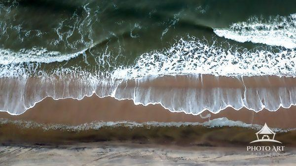 Top down shot of a wave crashing at Flying Point Beach, Water Mill, NY