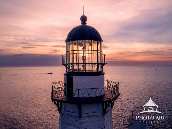Montauk Lighthouse Lantern Room at sunrise with fishing trawler in background