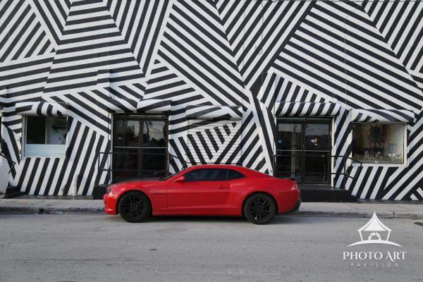 A pop of red against the black and white texture of a building in Wynwood, Miami.