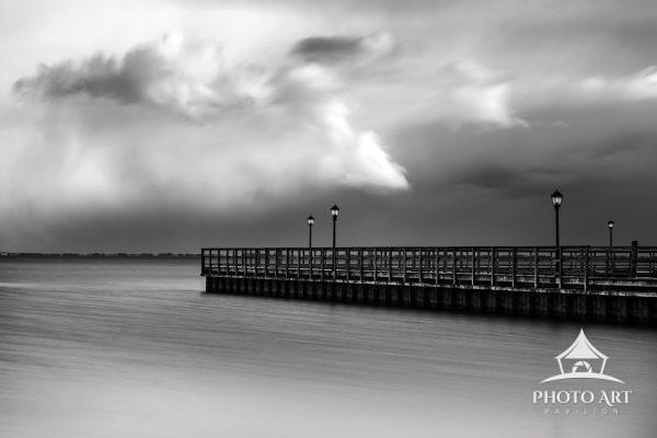 Beautiful long pier stretching out into the Great South Bay, under and interesting and overcast sky.